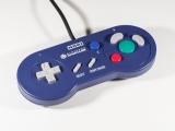 Een mooie controller met nostalgisch tintje in de vorm van een Super Nintendo System controller.