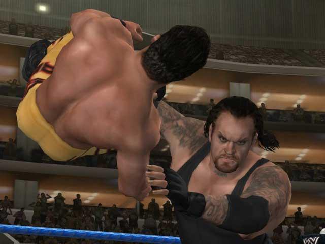 The Undertaker grijpt zijn tegenstander!